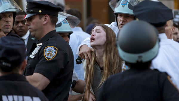 """A protester screams Wednesday as she is detained by New York police during a demonstration in the Manhattan borough of New York. Billed as """"NYC Rise Up & Shut it Down With Baltimore,"""" the demonstration was being held to support Baltimore's protests against police brutality."""