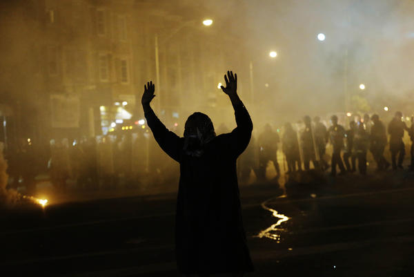 "What do you see in this image? An ""uprising"" or a ""riot""?"