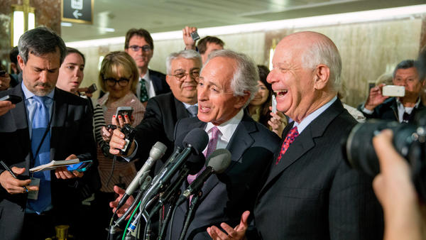 Senate Foreign Relations Committee Chairman Sen. Bob Corker, R-Tenn., center, and the committee's ranking member Sen. Ben Cardin, D-Md., right, were all smiles April 14 after the committee passed an agreement on oversight of Iran negotiations. But the bill has run into some outspoken opponents in the full Senate.