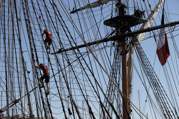 Sailors climb in the three masts of the 213-foot-long frigate Hermione during preparations to sail across the Atlantic, in La Rochelle, southwestern France.