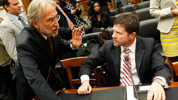 Neil Portnow (left), president and CEO of The Recording Academy, talks with Lee Thomas Miller, head of the Nashville Songwriters Association International, at a music licensing hearing in 2014.