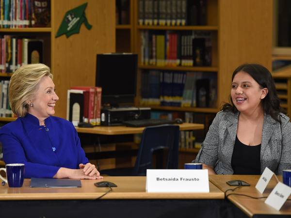 "Democratic presidential candidate and former U.S. Secretary of State Hillary Clinton speaks with student Betsaida Frausto on May 5 at Rancho High School in Las Vegas. Clinton said that any immigration reform would need to include a path to ""full and equal citizenship."""