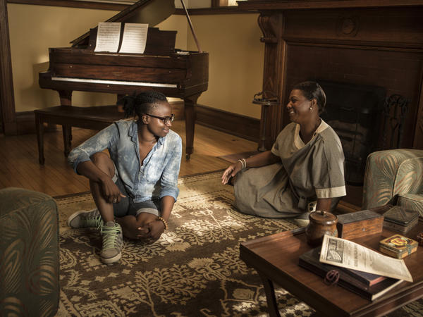Director Dee Rees (left) with Queen Latifah on the set of <em>Bessie</em>.