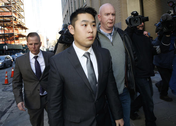 NYPD Officer Peter Liang arrives at Kings County Supreme Court in Brooklyn, N.Y., after being indicted for the fatal shooting of an unarmed man while patrolling the darkened stairwell of a Brooklyn housing project last November.