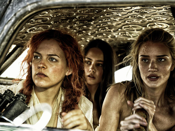 Riley Keough, Courtney Eaton and Rosie Huntington-Whitely play a warlord's wives, who team up with Theron's Furiosa.