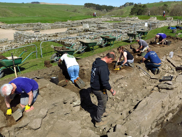 Andrew Birley (standing in center front), director of excavations, works among volunteer archaeologists at Vindolanda in northern England. For close to a century, the Birley family has led excavations at the 2,000-year-old Roman site.