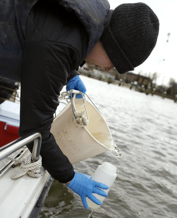 Anna McCall, a biology student at Gallaudet, collects water samples from the Anacostia River in Washington, D.C.