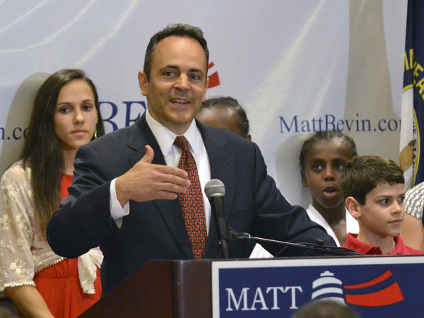Kentucky Republican gubernatorial candidate Matt Bevin addresses supporters in Louisville, Ky., Tuesday. He leads the GOP primary by 83 votes.
