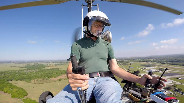 Doug Hughes flies his gyrocopter March 17 near the Wauchula Municipal Airport in Wauchula, Fla.