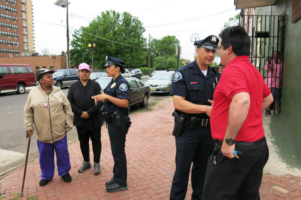 Camden County Police Officer Virginia Matias and Officer Jose Vale often walk together when on foot patrol in Camden. Matias patrols sections of the city on foot so she can strike up conversations with business owners and residents. She says this makes her more familiar with what's going on than she would be if she stayed in her patrol car all day.
