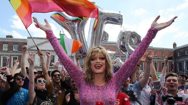 Drag queen and gay rights activist Rory O'Neill, also known by the stage name, Panti, celebrates with supporters of same-sex marriage at Dublin Castle as they await the result of the referendum on Saturday.
