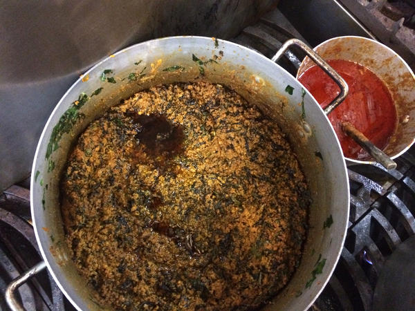 One of Wey's staple menu items is Jollof rice, made with rosy palm oil.