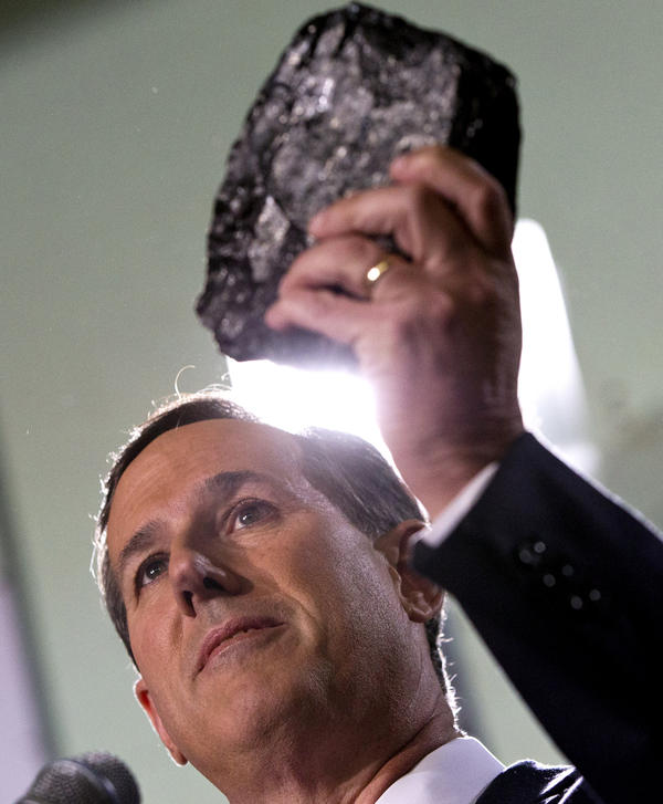 Former Pennsylvania Sen. Rick Santorum holds up a piece of coal while announcing that he is entering the Republican presidential race.