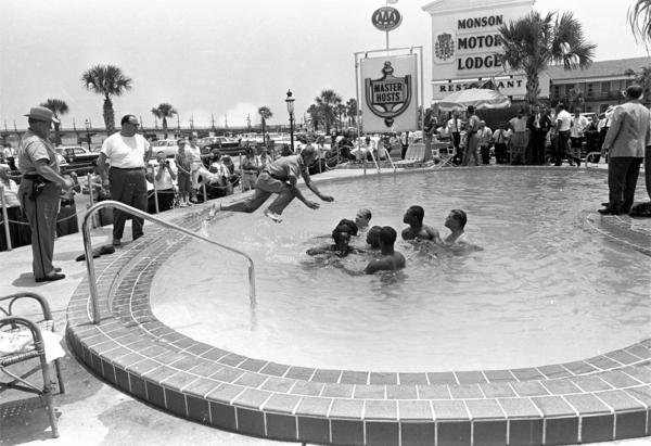When the group of white and black integrationists refused to leave the motel's pool, this man dived in and cleared them out. All were arrested.