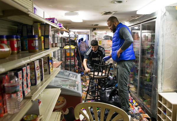 Volunteers clean up a business damaged during an evening of riots following the funeral of Freddie Gray on April 28 in Baltimore.