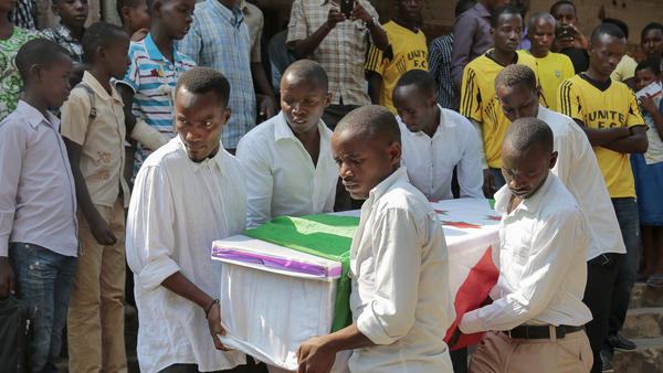 The coffin of Theogene Niyondiko, who was shot dead by police during an opposition demonstration last Friday, is carried in Burundi's capital Bujumbura on Tuesday. Protesters have been demonstrating against President Pierre Nkurunziza, who plans to run for a third term next month.