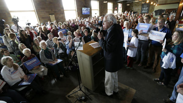 "Vermont Sen. Bernie Sanders speaks with Iowa residents last month. ""One of the first things that I would do as president, and what I am doing right now in this campaign,"" he said Wednesday, ""is to put together a strong, unprecedented grass-roots movement which tells Congress that they've got to start representing ordinary people, and not just the people on top."""