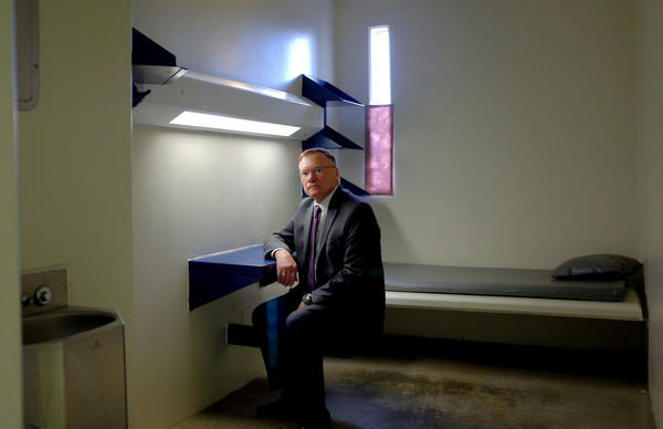 Rick Raemisch, the director of Colorado's Department of Corrections, poses for a portrait in a solitary confinement cell similar to the one he stayed in during a tour of the Colorado State Penitentiary in 2014.