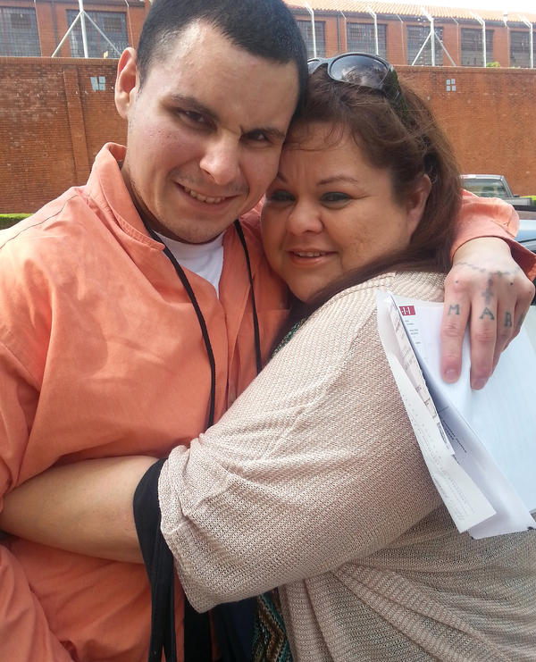 Garcia hugs her son, Mark, on the day he was released from solitary confinement in July 2014.