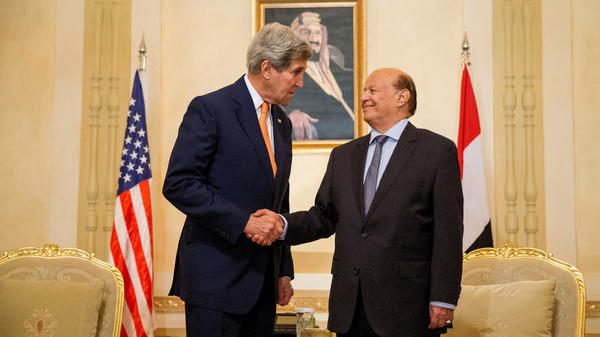 U.S. Secretary of State John Kerry, left, shakes hands with Yemen's ousted president, Abed Rabbo Mansour Hadi on May. 7 in Riyadh, Saudi Arabia. Hadi and top officials in his former government have been living in a guest palace in the Saudi capital following his ouster by Houthi rebels. Talks on ending Yemen's war begin Sunday in Geneva.