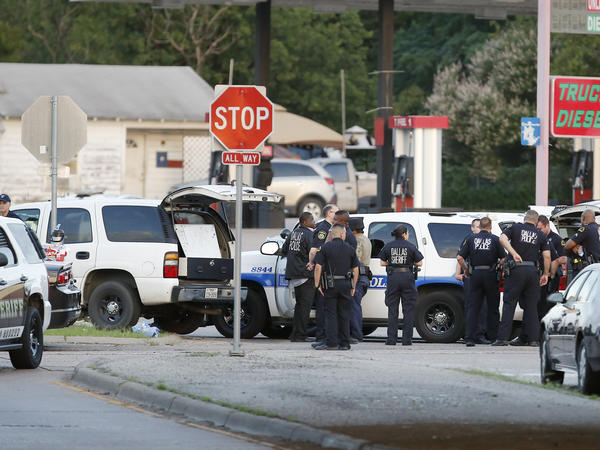 Police block the intersection of Dowdy Ferry Rd. and Interstate 45 during a standoff with a gunman barricaded inside a van in Hutchins, Texas.