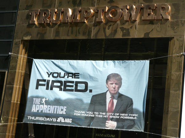 A sign advertising Trump's television show <em>The Apprentice</em> hangs at Trump Towers in New York City in 2004.