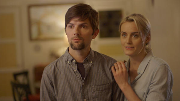 Adam Scott and Taylor Schilling in <em>The Overnight</em>.