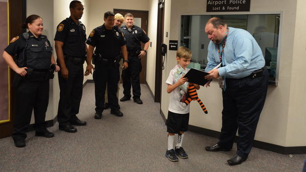 Owen, 6, is reunited with his tiger, Hobbes. He had left the stuffed animal at the airport.