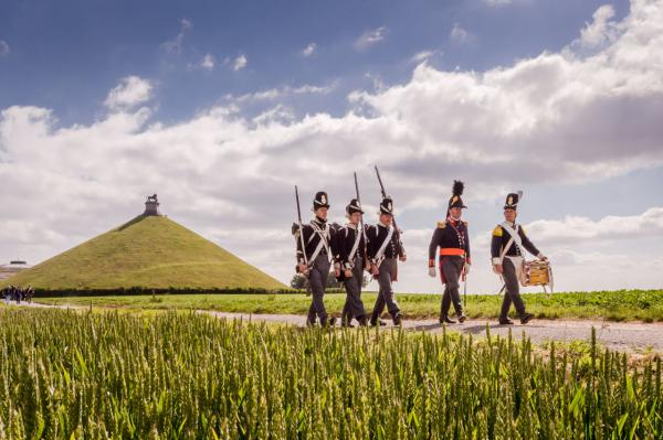 Battle of Waterloo re-enactors walk near the Lion's Mound during a historical walk for journalists in Braine-l'Alleud, near Waterloo, Belgium. On Wednesday, June 17, 2015, four days of commemoration will begin on the historic battlefield, with the re-opening of Hougoumont farm and a reconstruction of the battle with more than 5,000 re-enactors. (Geert Vanden Wijngaert/AP)