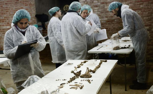 Archaeologists in Madrid study remains buried under the Convent of the Barefoot Trinitarians on Jan. 24. Tests proved the remains belonged to Miguel de Cervantes, the author of <em>Don Quixote</em>. Cervantes wanted to be buried at the convent because the nuns raised money and paid a ransom for his release when he was a young man held captive in North Africa.