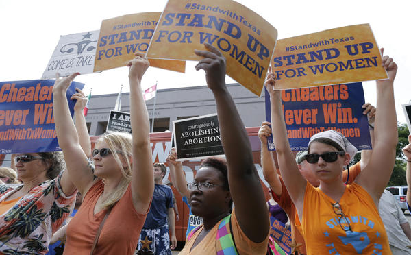 On July 9, 2013, opponents and supporters of a bill to put restrictions on abortion hold signs near a news conference outside the Texas Capitol in Austin. The bill was passed, but has been battled in the courts for two years; now, the law is set to go into effect July 1.