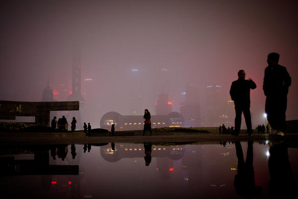 People walk on the Bund, the riverfront area next to the financial district in Shanghai. Many foreigners have descended on Shanghai to make money on China's economic expansion. NPR's Frank Langfitt met one such woman as part of the free taxi rides he's been offering.