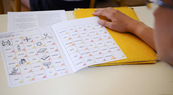 A student attends a course on religion at a middle school in Metz, in eastern France, on June 5. French schools teach basics, like the history of religion, but discourage any displays of religious identity.