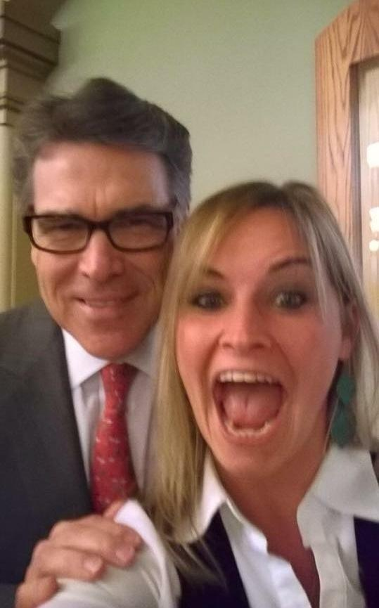 Maggie Fitzgerald, seen here with former Texas Gov. Rick Perry, just might hold the record for most selfies with 2016 presidential candidates. A state lobbyist based in Des Moines, she has also posed with Bobby Jindal, Donald Trump, Ben Carson and Hillary Clinton.