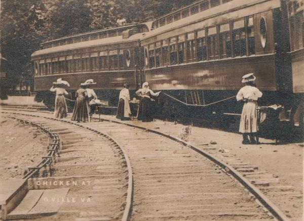 Waiter carriers sell their wares along the platform. According to Williams-Forson's book, Bella Winston's mother is one of the women pictured in this photo.