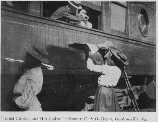 Waiter carriers pass food to passengers on a train stopping in Gordonsville, Va., in this undated photo. After the Civil War, local African-American women found a route to financial  freedom by selling their famous fried chicken and other home-made goods track-side.