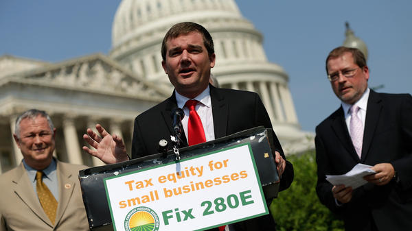 """Aaron Smith, executive director of the National Cannabis Industry Association, speaks about taxes on marijuana outside the Capitol in 2013. """"Any industry that is heavily regulated by the government has to have an active voice,"""" the group's deputy director recently said."""