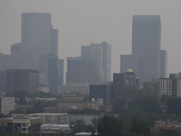 Smoke drifting south from wildfires burning in Canada clouds the skyline last week in Denver.