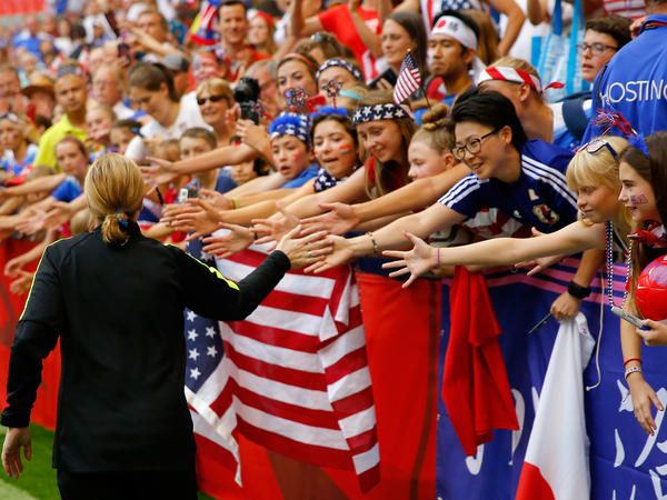 Head coach Jill Ellis of the United States celebrates with fans after the USA's 5-2 victory against Japan in the FIFA Women's World Cup Canada 2015 Final in July.