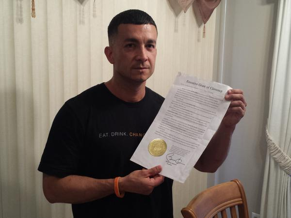 "Jason Hernandez holds the piece of paper that changed his life --€"" the letter from President Obama commuting his sentence."