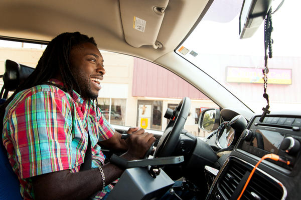 Emeka Nnaka, who uses a wheelchair, drives his new accessible van to meet a friend in Tulsa, Okla. The van allows the 27-year-old greater independence, making it easier to get to school and work and to have a social life. Six years ago, Nnaka, then a semipro football player, broke his neck during a tackle and was paralyzed.