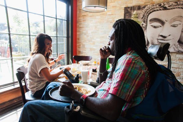 During lunch with his friend Jacquelyn Croudy, Nnaka asks the server for a tray so that he can keep his food in his lap; he says that's easier than trying to get his legs under the table.