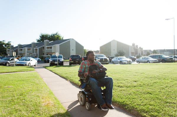 Nnaka arrives home to his apartment in South Tulsa after a long day.