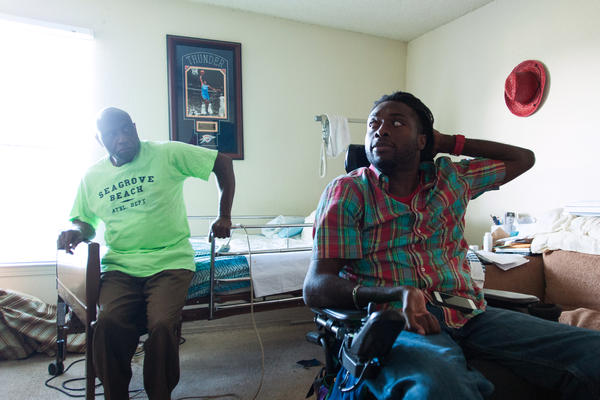 Nnaka and his father, Phillip, chat in Emeka's room.