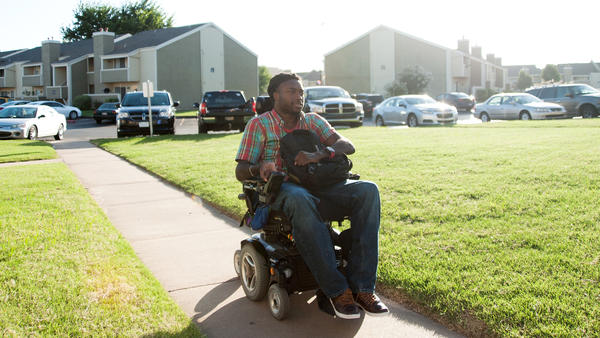 After a long day, Emeka arrives home to the apartment in South Tulsa that he shares with his father.