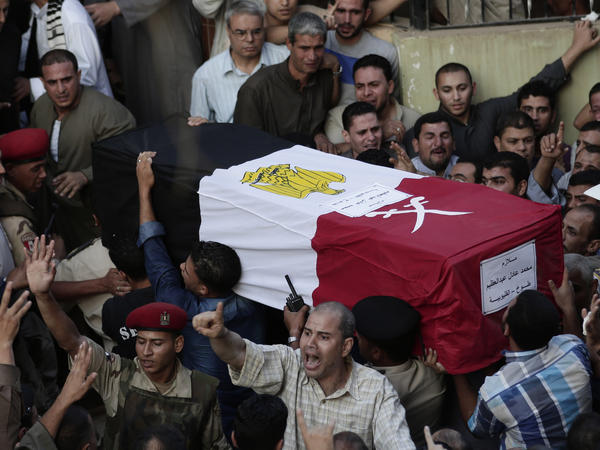 Egyptians carry the coffin of 1st Lt. Mohammed Adel Abdel Azeem, one of more than 20 Egyptian military personnel killed  by militants in the Sinai on July 1.