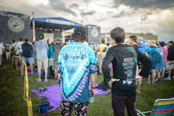 Two Pink Floyd fans stand in unexpected sunshine during Roger Waters' set at the 2015 Newport Folk Festival.