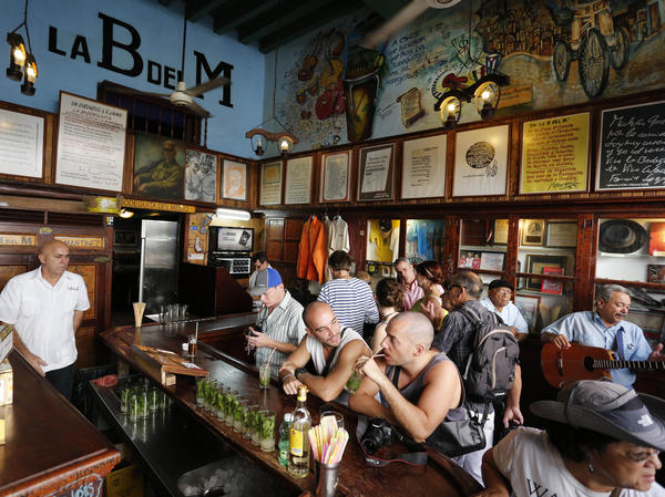 Tourists fill the famous La Bodeguita del Medio bar where U.S. author Ernest Hemingway used to drink in Old Havana, Cuba.