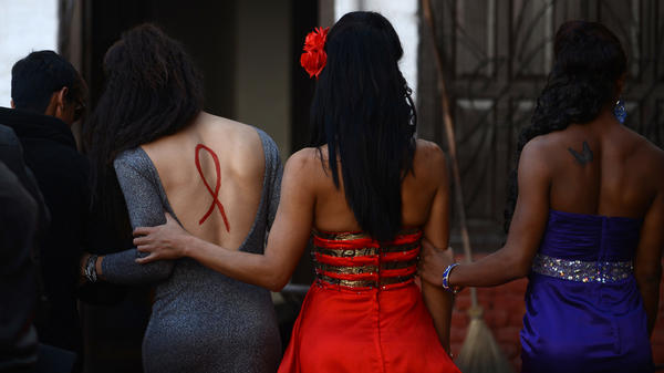 Transgender performers walk backstage during an event to mark World AIDS Day in 2013. A new WHO report demonstrates extremely rates of HIV infection among transgender women in 15 countries.