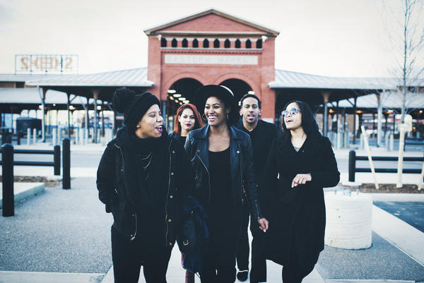 Paige Watkins (from left), Sarah Johnson, Camille Johnson, Chris Turner and Devon Porter stand in front of Detroit's Eastern Market. They are all contributors to Black Bottom LLC, a project committed to recapturing the vibrancy of the Black Bottom community.